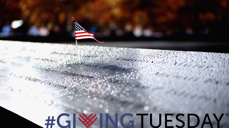 "A graphic features a photo of an American flag placed into the Memorial pool with fall foliage in the background. In the bottom right corner ""#GivingTuesday"" is written."