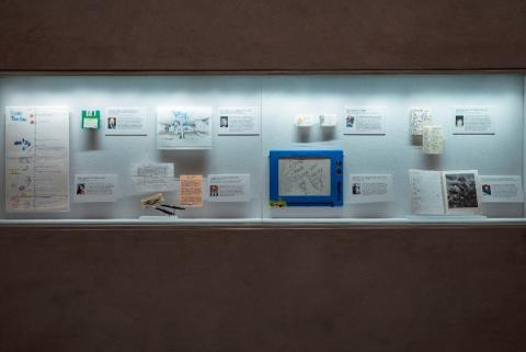 In this interior look at the In Memoriam exhibition, one can see personal items that belonged to victims of the attacks on view in a display case.